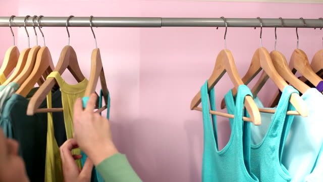 Closeup of girl looking at clothing video