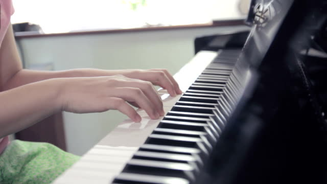 Close-up of girl playing the piano,Dolly shot video