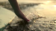 Close-up of girl's hand moving through the water video