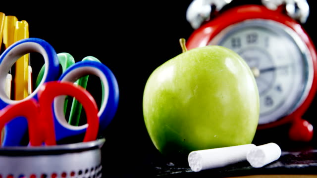 Close-up of green apple with school supplies video