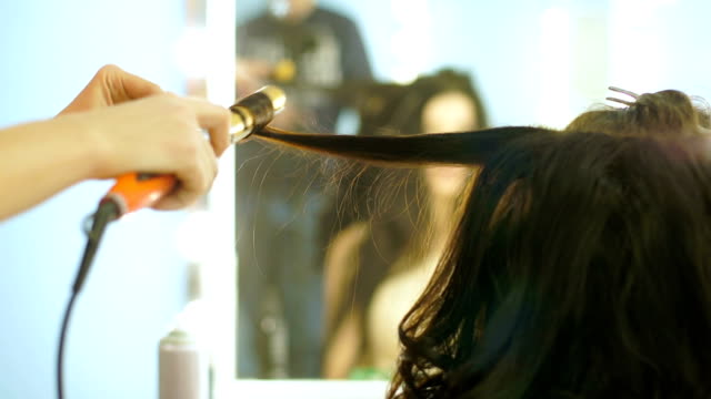 Close-up of hairdresser doing beautiful wedding hairstyle 1 video