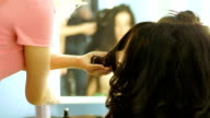 Close-up of hairdresser doing beautiful wedding hairstyle 2 video