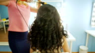 Close-up of hairdresser doing beautiful wedding hairstyle 3 video