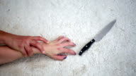 closeup of hand of woman struggling with man and a knife video