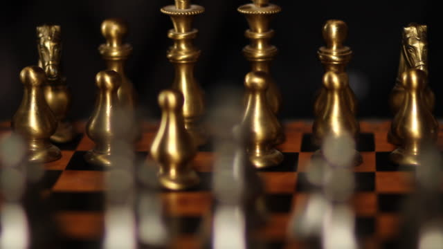 Close-up of hand playing chess, dolly shot video