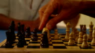 Close-up of hands playing chess video