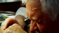 Close-up of horologist repairing a watch video