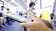 Close-up of Human Hand typing virtual keyboard on the train video