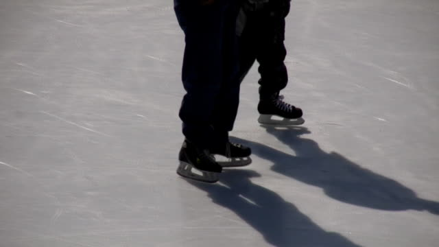 Closeup of ice skater's feet (High Definition) video