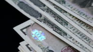 closeup of Japanese yen bank noted with high speed camera video