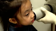 Closeup of little girl at dental clinic video
