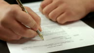 Closeup of male hand signing contract, businessman making deal video