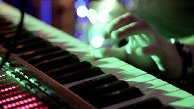 Closeup Of Male Hands Playing Piano. Man Playing The Synthesizer Keyboard. Man Plays Music Keyboard. Musician Plays Piano. A Musician Playing A Musical Instrument DJ plays the piano at the party video