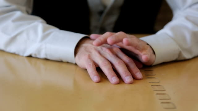 closeup of male hands tapping on desk video