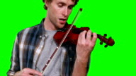 Close-up of male musician singing while playing violin video