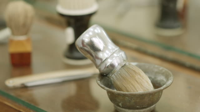 Close-up of man at work as barber preparing shaving cream video