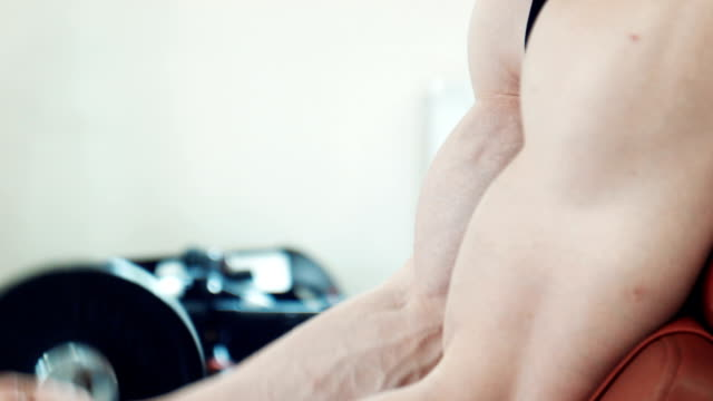 Close-up of man doing biceps curls video