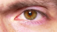 Close-up of man eye opening video