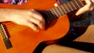 Closeup of man playing guitar with friends at beach video
