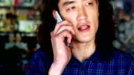 Close-up of man talking on mobile phone video