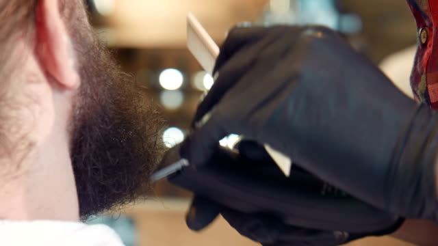 Close-up of man's beard being groomed video