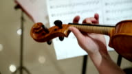 Close-up of musician playing violin, classic music video