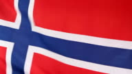 Closeup of Norwegian national flag in slow motion video