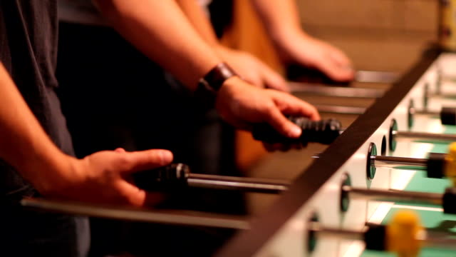 Close-Up of People Playing Foosball video