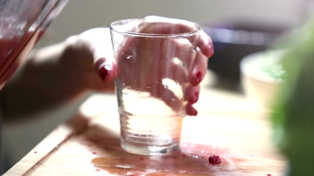 Close-up of pouring fruit smoothie into glass video