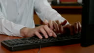 Close-up of programmer hands having a third hand typing video