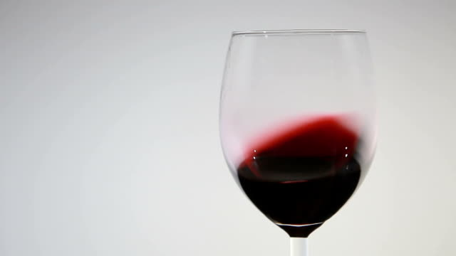close-up of red wine swirling in a glass video