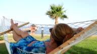 Closeup Of Relaxing Woman In Hammock video