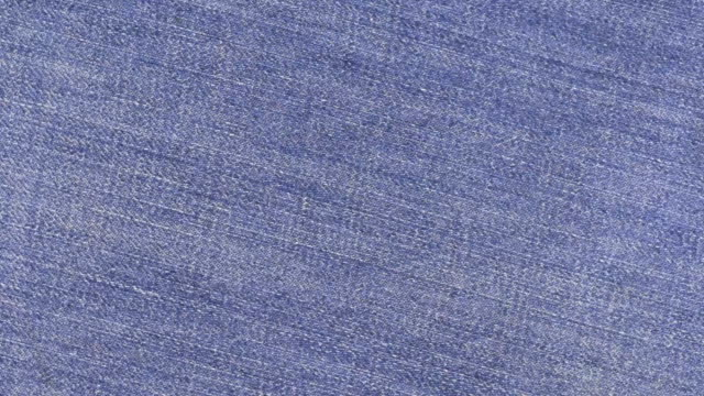 Close-up of rotation denim texture . video