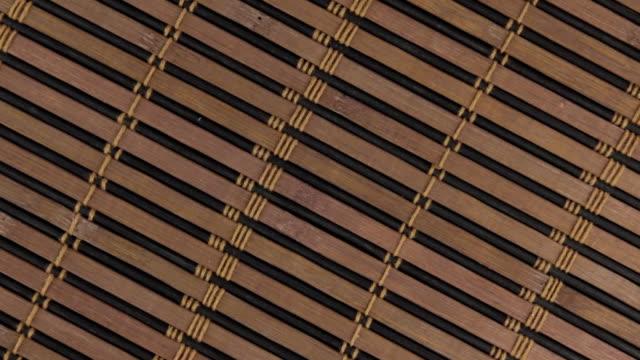 Close-up of rotation texture bamboo mat. video