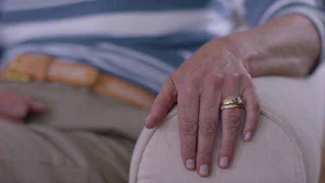 Closeup of senior couple's hands video
