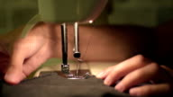 Closeup of sewing machine with the hands video