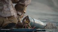 Close-up of Soldier Defusing a Bomb by Cutting a Wire During Military Operation in Desert Environment video