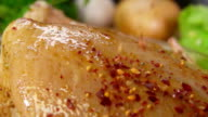 Close-up of spices on the chicken falls video
