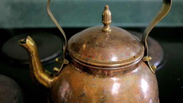 Closeup of Steam Boiling From a Copper Tea Kettle on a Stove Top video