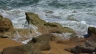 Closeup of Surf Breaking Over Boulders video