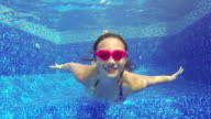 Close-up of teenage girl Blowing bubbles swimming  underwater video