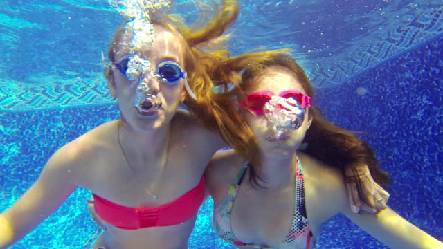Close-up of teenage girls Blowing bubbles underwater video