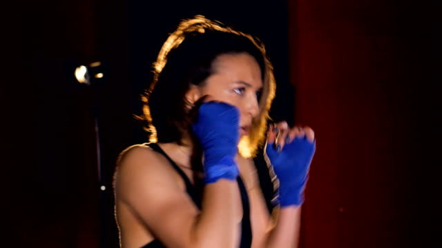 Close-up of the boxing girl. Portrait. 4K video