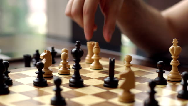 Close-up of the hand of a man playing chess. video