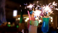Close-up of three cocktails decorated with sparklers video