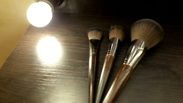 Close-up of three make-up brushes on the table. video