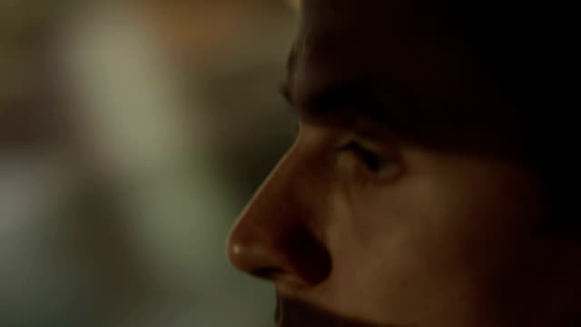Closeup of tired man driving car at night. Dangerous maniac video
