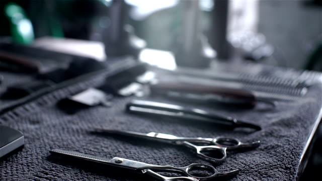 Closeup of tools, scissors, comb and razor in barber shop video