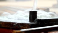 Close-up of water cooling hot metal video