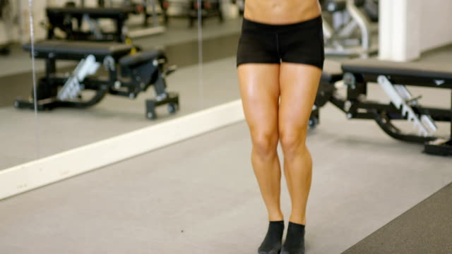 Close-up of woman jumping rope in gym video